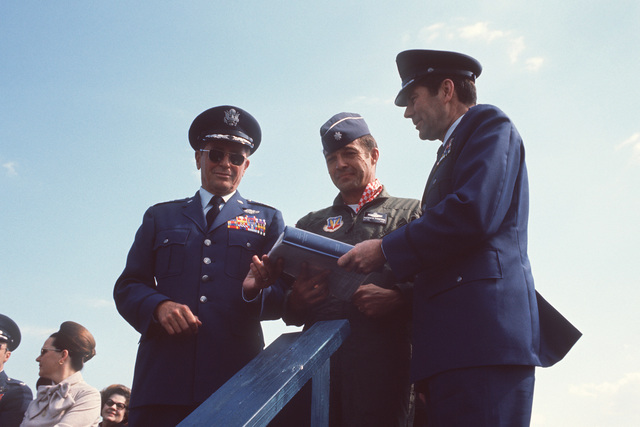 General William J. Evans, right, commander of the Air Force Systems Command, officially turns over the first operational A-10 Thunderbolt II aircraft to General Robert J. Dixon, left, commander of the Tactical Air Command, during a ceremony on the flight line. The pilot of the A-10, center, looks on