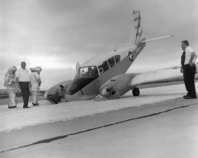 A left front view of a U-11A Aztec aircraft that crashed at Naval Air Station, North Island after the nose gear failed to operate properly