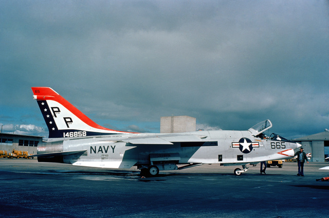 A right side view of a Light Photographic Reconnaissance Squadron 63 (VFP-63) RF-8G Crusader aircraft parked on the flight line. The aircraft has been painted in Bicentennial theme