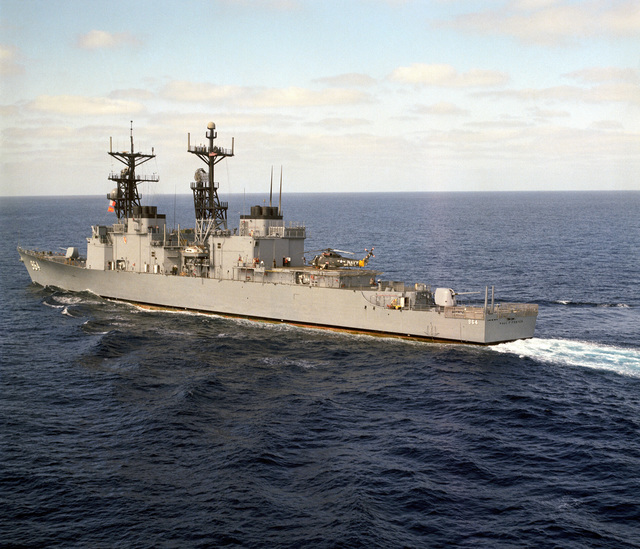 A port quarter view of the destroyer USS PAUL F. FOSTER (DD 964) underway off the coast of Southern California. A Light Helicopter Anti-submarine Squadron 33 (HSL-33) SH-2F Seasprite helicopter can be seen aboard the ship