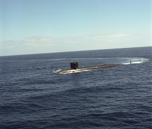 A starboard bow view of the nuclear-powered attack submarine USS PLUNGER (SSN 595) underway off the Southern California coast