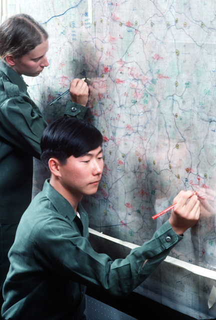 US Army intelligence specialists plot points on a map