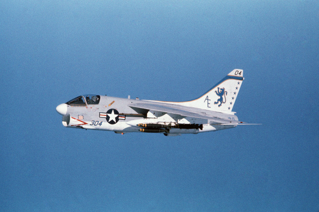 An air-to-air left side view of an Attack Squadron 15 (VA-15) A-7E Corsair II aircraft from the aircraft carrier USS AMERICA (CV 66).  The aircraft is armed with Mark 82 500-pound bombs