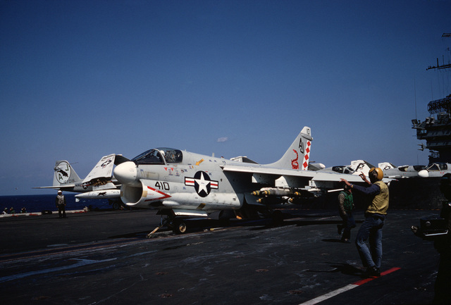 An Attack Squadron 82 (VA-82) A-7E Corsair II aircraft is hooked to a catapult and prepared for launch from the aircraft carrier USS AMERICA (CV 66)