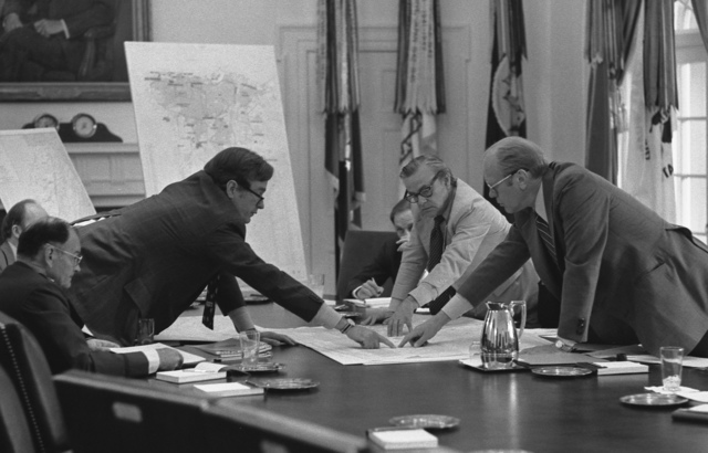 Photograph of Central Intelligence Agency (CIA) Director George Bush Discussing the Evacuation of Americans from Beirut with President Gerald R. Ford during a Meeting in the Cabinet Room