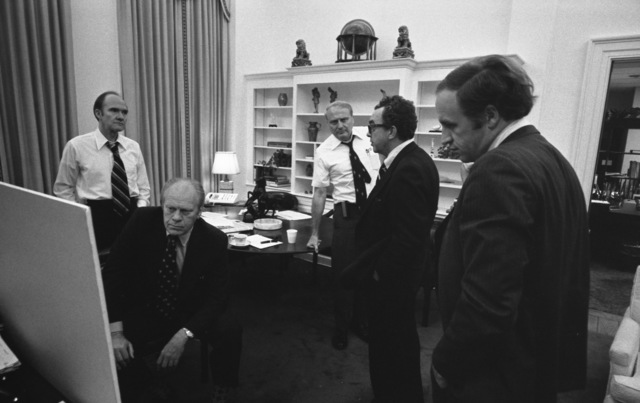 Photograph of President Ford Monitoring the Evacuation of American Citizens from Beirut, Lebanon From the Office of National Security Adviser Brent Scowcroft in the Early Morning Hours
