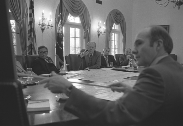 Photograph of President Gerald Ford and National Security Adviser Brent Scowcroft Pointing to a Map of Beirut, Lebanon during Discussions on the Evacuation of Americans