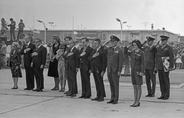 Photograph of President Gerald Ford and Secretary of State Henry Kissinger Joining the Meloy and Waring Families at Andrews Air Force Base for the Arrival Ceremony of the Remains of U.S. Ambassador to Lebanon Francis E. Meloy, Jr. and Economic Counselor Robert O. Waring