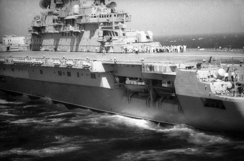 A port quarter view of the flight deck and island of the Soviet aircraft carrier KIEV (CVHG).  Ship's boats are stored in hull recesses under the flight deck