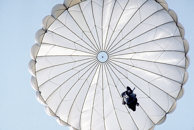 A US Army soldier parachutes to the ground during a training exercise