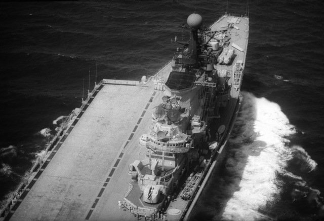 An elevated starboard view of the island and flight deck of the Soviet aircraft carrier KIEV (CVHG) while the ship is underway