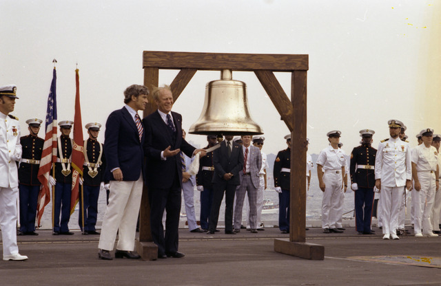 Photograph of President Gerald R. Ford Initiating the Ringing of Bicentennial Bells across the Nation on the Flight Deck of the USS Forrestal with American Revolution Bicentennial Administration Administrator John Warner