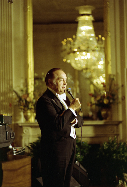 Comedian Bob Hope Delivering a Monologue in the East Room during the Entertainment Portion of a State Dinner Honoring Queen Elizabeth II and Prince Philip of Great Britain
