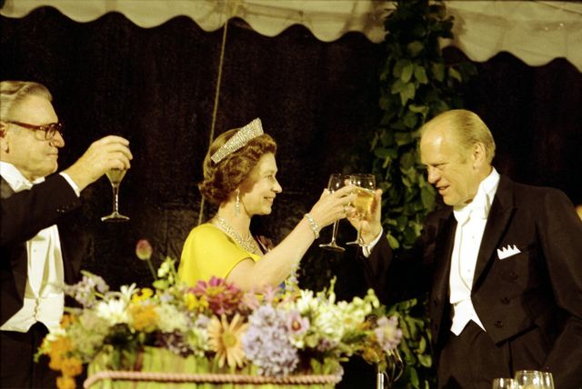 President Gerald R. Ford, Vice President Nelson A. Rockefeller, and Queen Elizabeth II of Great Britain Raising Their Glasses in a Toast at a State Dinner Honoring Her Majesty and Prince Philip