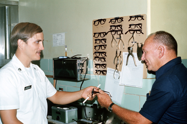 SSGT Paul Catles, an eye specialist, examines Frederick Mayes, USA, (Ret.) in the optometry clinic at Kenner Army Hospital