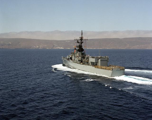 An aerial port quarter view of the frigate USS BRADLEY (FF 1041) underway near San Clemente Island
