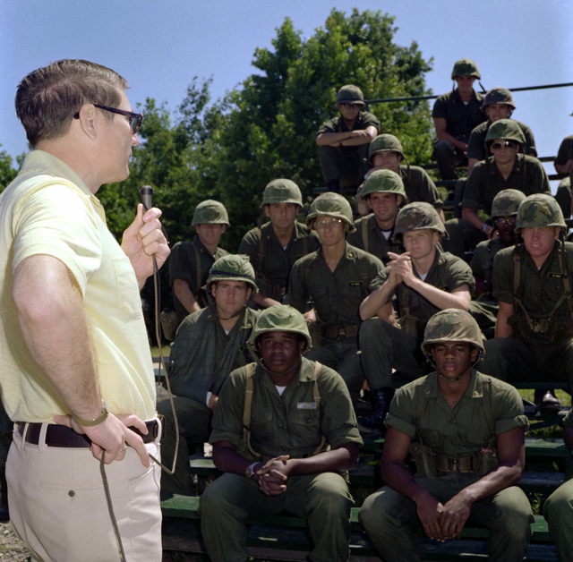 Assistant Secretary of the Navy G.D. Penisten speaks to Navy midshipmen at Murphy's Demo Range during a visit to the Marine Corps Development and Education Command