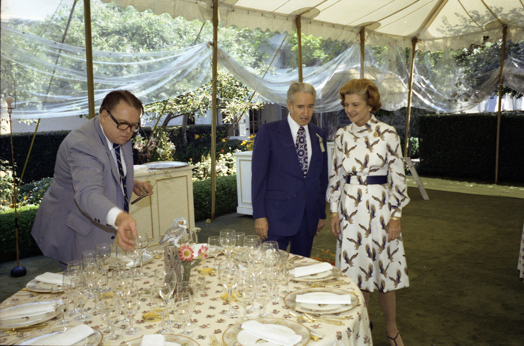 First Lady Betty Ford with Two Unidentified Men Looking at Table Settings and Decorations in the Tent on the South Lawn of the White House during Preparations for a State Dinner Honoring Chancellor Helmut Schmidt of the Federal Republic of Germany