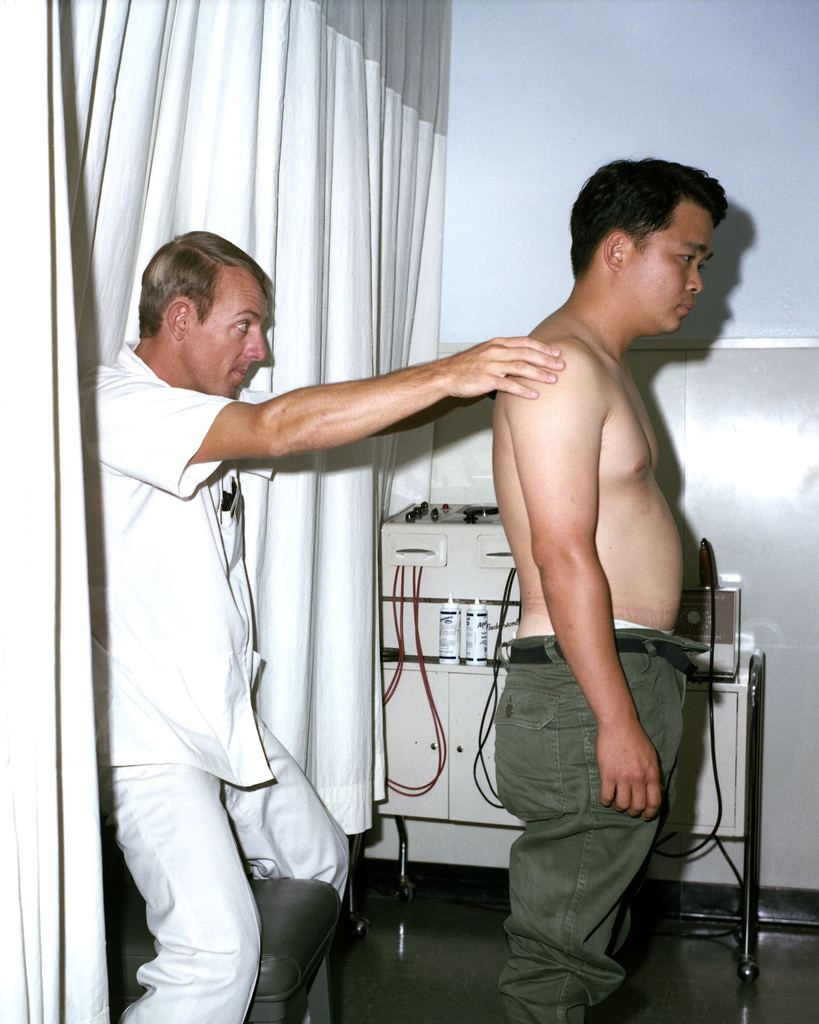 Major Doug A. Dersey, a physical therapist, checks the range of motion of a patient being treated for back pain at Darnall Army Hospital