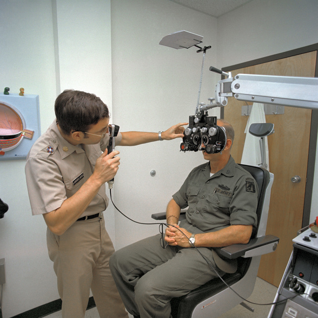 Major Leonard Langeliers performs an eye examination on CHIEF Warrant 4 Authur D. Brown in the optometry clinic at Womack Army Hospital