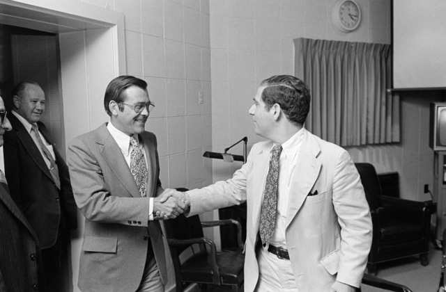 The Honorable Donald H. Rumsfeld (center), U.S. Secretary of Defense, is greeted by Mr. Vic Rattner, ABC Radio News, as he arrives at the Pentagon Studio, Washington, D.C., Jul. 19, 1976.   (DoD photo by Mr. Ron Hall) (Released)