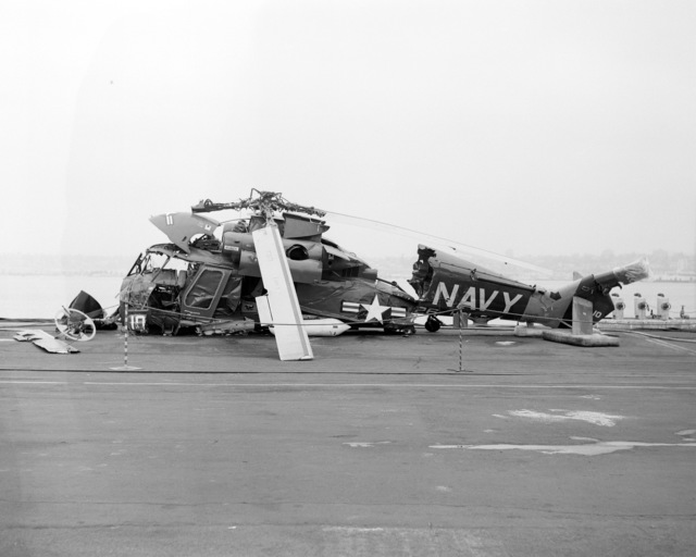 A left side view of an SH-2F Seasprite helicopter that crashed in San Diego Harbor. The helicopter is assigned to Light Helicopter Anti-submarine Squadron 33 (HSL-33)