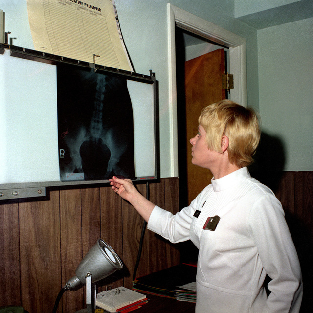 SPEC. 5 Sandi Junker, an X-ray technician assigned to the Medical Department Activities Co., an X-ray at the Health Clinic
