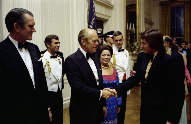 President Gerald R. Ford Shaking Hands with Tennis Player Jimmy Connors in the Receiving Line at a State Dinner Honoring Prime Minister Malcolm Fraser of Australia
