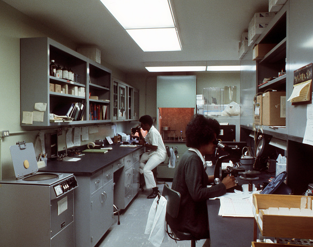 SPEC. 4's Grady and Christine Johnson, medical laboratory specialists who are also husband and wife, work in the lab at the medical department activity (MEDDAC) health services building