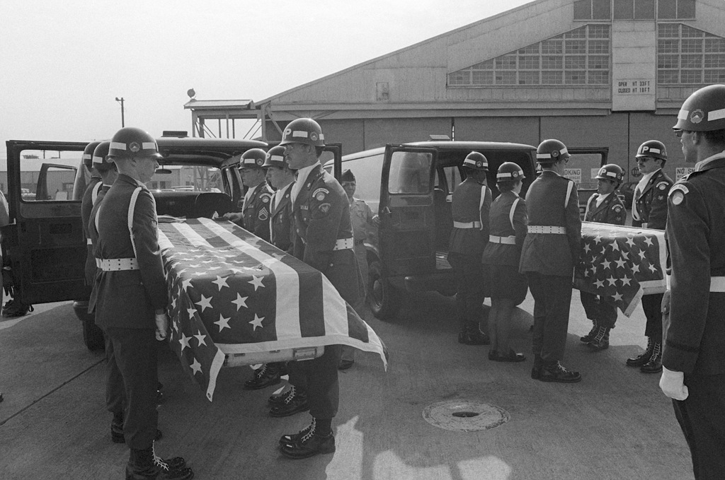 The caskets of Major (MAJ) Arthur G. Bonifas and First Lieutenant (1LT) Mark T. Barrett are placed in vans by a US Army military police honor guard. The officers were attacked and killed by a group of North Korean guards during an incident in the Joint Security Area, Panmunjom, Korea, on August 18,1976