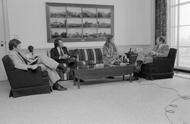 The Honorable Donald H. Rumsfeld (right), U.S. Secretary of Defense (SECDEF), is being interviewed by Nancy Raley (center, right), Georgetown Today, in the office of the SECDEF, Washington, D.C., Aug. 4, 1976.  OSD Package No. D-1998-OSD-76-080006 (PHOTO by Ron Hall) (Released)