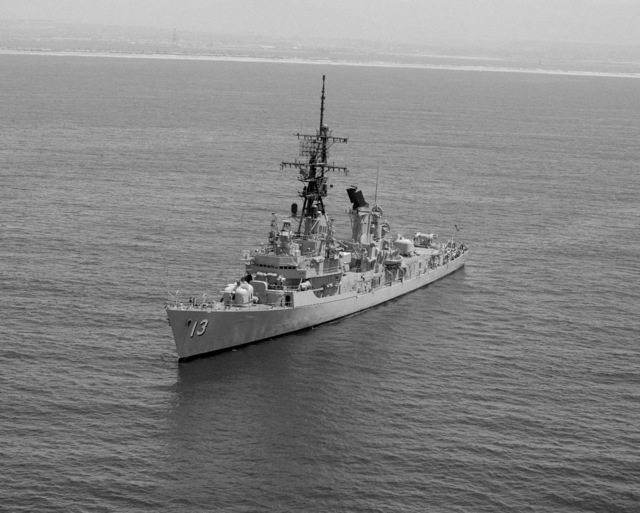 An aerial port bow view of the guided missile destroyer USS HOEL (DDG 13) underway near San Diego, California
