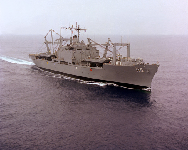 An aerial starboard bow view of the amphibious cargo ship USS ST. LOUIS (LKA-116) underway off the Southern California coast