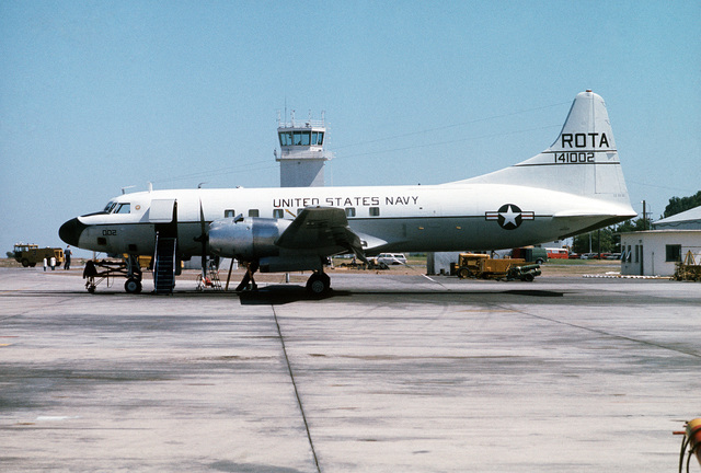 A left side view of a US Navy (USN) C-131F Samaritan aircraft parked on the flight line