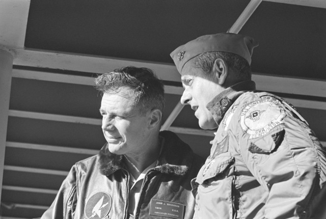 Vice Admiral John J. Shanahan, Commander, US Second Fleet, left, listens to a report from Rear Admiral Frederick F. Palmer, commander, Amphibious Group Two, aboard their flagship, the amphibious command ship USS MOUNT WHITNEY (LCC 20) en route to the allied Exercise TEAM WORK '76. The exercise is scheduled for September 15-24