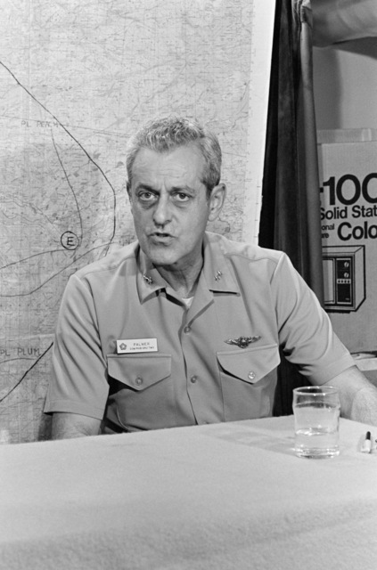 Rear Admiral Frederick F. Palmer, Commander, US Amphibious Group Two, holds a briefing aboard the amphibious command ship USS MOUNT WHITNEY (LCC 20) while en route to participate in the allied Exercise TEAM WORK '76. The MOUNT WHITNEY is serving as flagship during the exercise scheduled for September 15-24