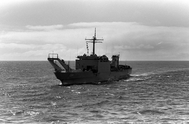 Aerial port bow view of the tank landing ship USS LA MOURE COUNTY (LST 1194) underway
