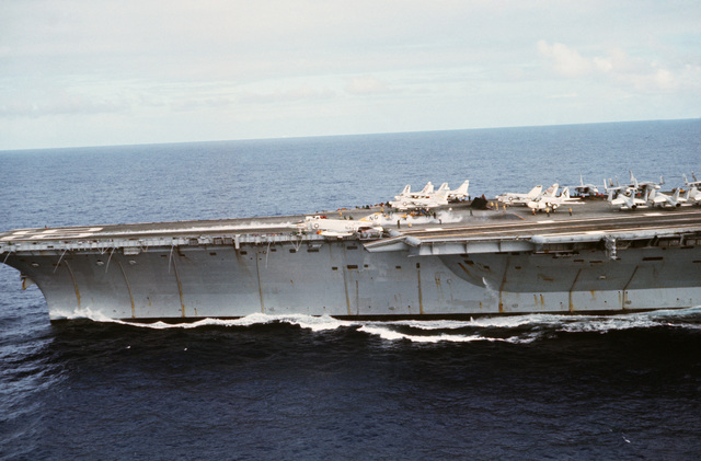 A port view of the forward half of the aircraft carrier USS AMERICA (CV 66) while the ship is underway