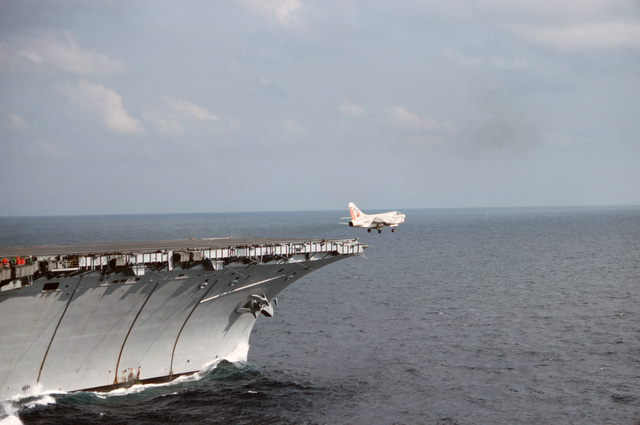 An A-7E Corsair II aircraft takes off from the bow of the aircraft carrier USS AMERICA (CV 66)