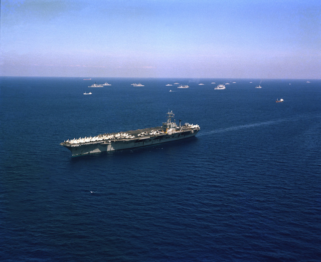 An aerial starboard bow view of the nuclear-powered aircraft carrier USS NIMITZ (CVN 68) underway during Operation DISPLAY DETERMINATION