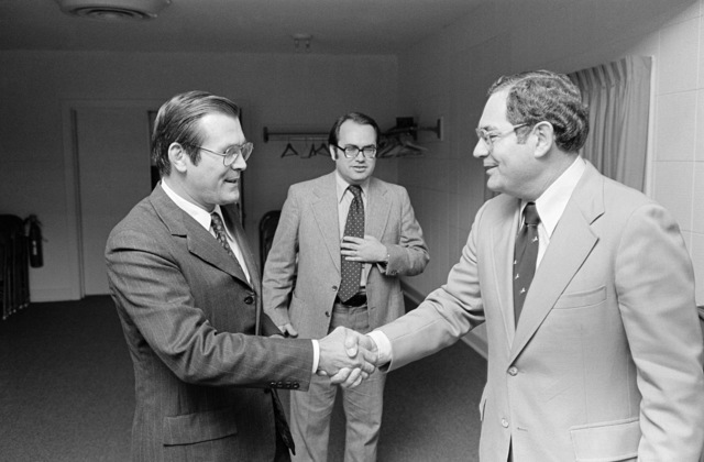 The Honorable Donald H. Rumsfeld (left), US Secretary Defense (SECDEF), is greeted by Mr. Frank Tomlinson, ABC-TV, as he arrives for an interview at the Pentagon Studio, Washington, D.C., Oct. 5, 1976. (DoD photo by Hall) (Released)