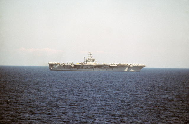 A starboard beam view of the nuclear-powered aircraft carrier USS NIMITZ (CVN 68) underway during NATO exercise DISPLAY DETERMINATION