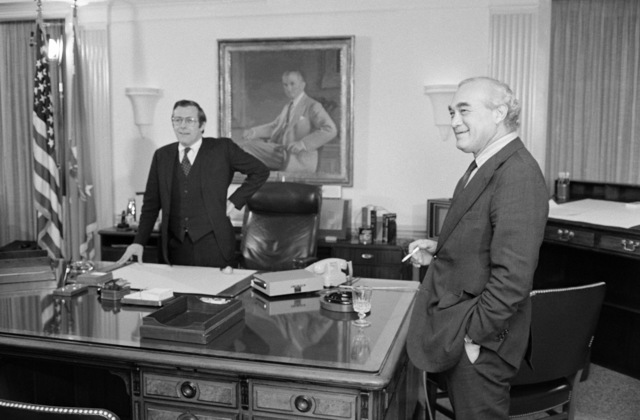 The Honorable Donald H. Rumsfeld, U.S. Secretary of Defense, left, chats with Martin Agronsky, right, from the Public Broadcasting Service (PBS) before an interview at his office at the Pentagon, Washington, D.C., on Nov. 3, 1976. OSD Package No. D-1998-OSD-76-110014 (PHOTO by Robert D. Ward, CIV) (Released)