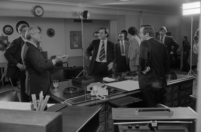 The Honorable Donald H. Rumsfeld, U.S. Secretary of Defense, right, chats with Martin Agronsky from the Public Broadcasting Service (PBS) before an interview at his office at the Pentagon, Washington, D.C., on Nov. 3, 1976. OSD Package No. D-1998-OSD-76-110014 (PHOTO by Robert D. Ward, CIV) (Released)