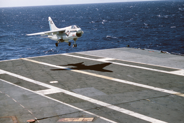 An A-7E Corsair II aircraft lands on the aircraft carrier USS AMERICA (CV 66)