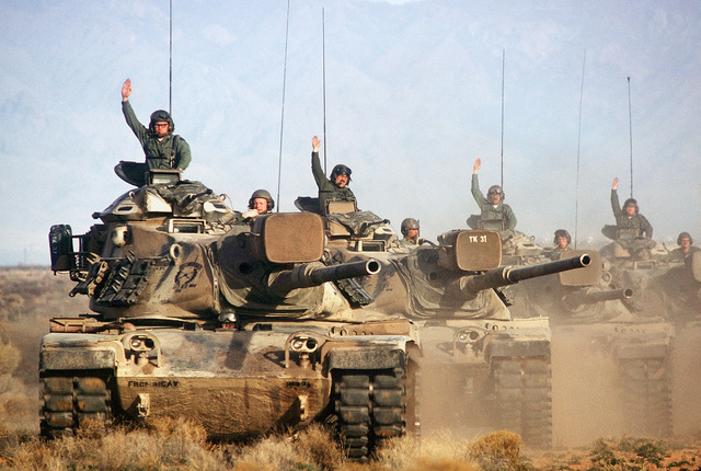 A convoy of M-60 main battle tanks move out during a training exercise