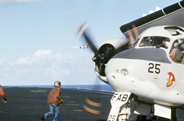A parked Brazilian S-2G Tracker aircraft starts up its engines during flight operations aboard the aircraft carrier USS AMERICA (CV 66) while underway off the coast of Rio de Janiero