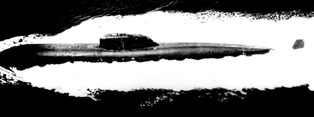A port beam view of a Soviet Charlie class cruise missile submarine underway