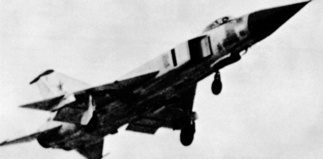 A right front underside view of a Soviet Su-15 Flagon-A fighter aircraft in flight. (Substandard image)