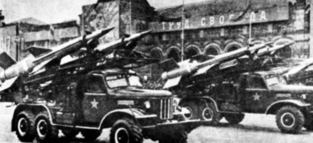 A right front view of several vehicle-mounted Soviet SA-3 Goa surface-to-air missiles